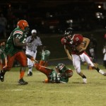 NFC Clint Trickett #16  trying avoid FAMU DL Ian Howard #50