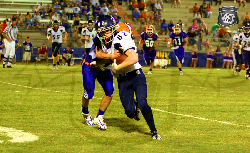 A Branford defender attempts to bring down Taylor Miller, no. 82 for Maclay.