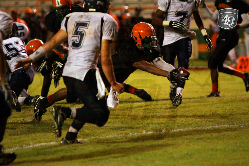 The Rattler, Jordan Stanley, dives in for the touchdown.