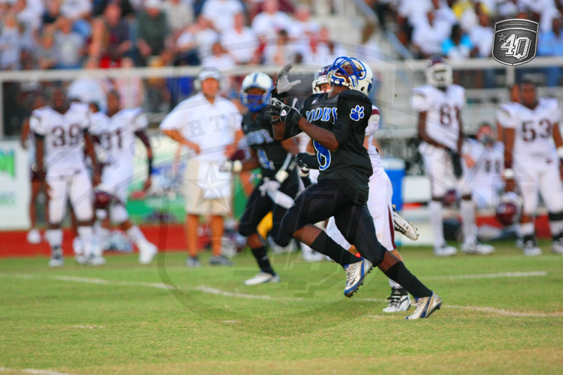 Godby WR #8 C. St. Hilaire looks in a deep pass against the Madison County defense