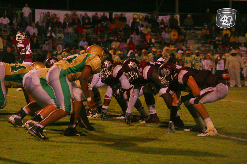 The Madison County offense lines up against the Lincoln Trojan defense