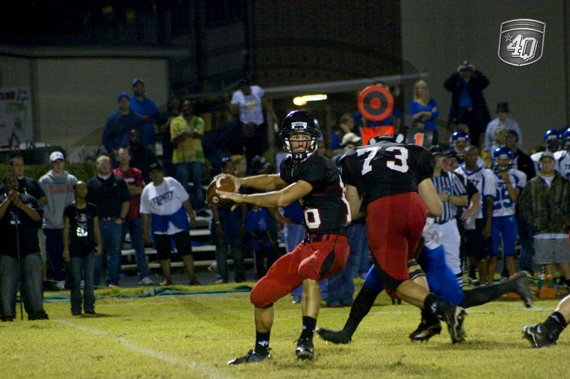 NFC QB #16 C. Trickett makes a throw, while Lineman #73 D. Gentry blocks a defender