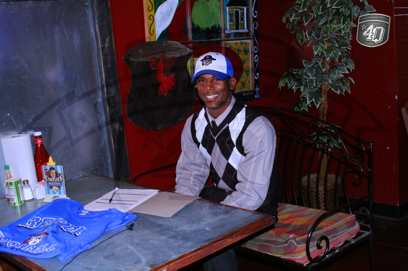 Mychal Poole is all smiles after committing to Iowa Western Community College