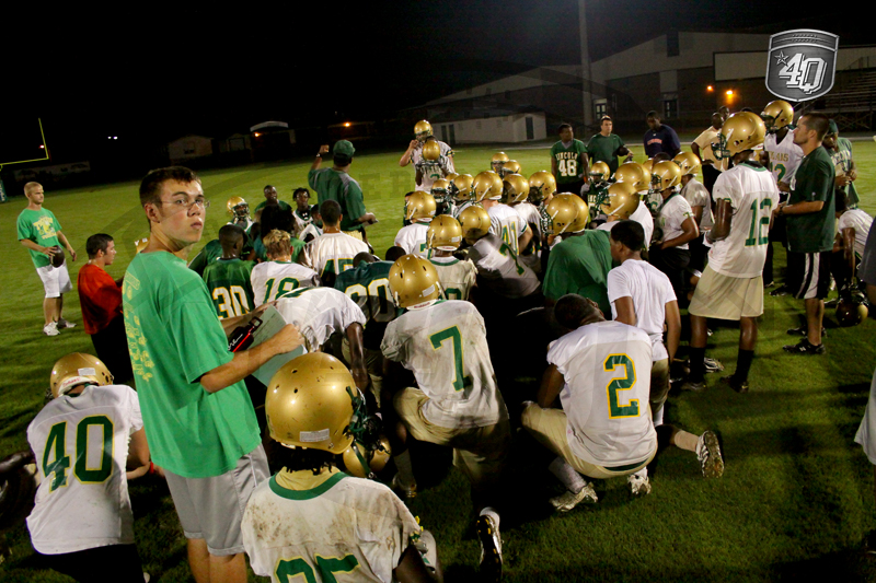 The Lincoln Trojans gather together at the conclusion of the 2010 Midnight Madness.