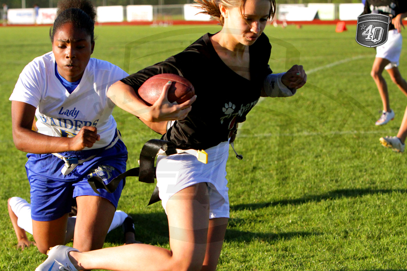 Lady Raider attempts to make the tackle.
